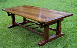 teak table with bread board